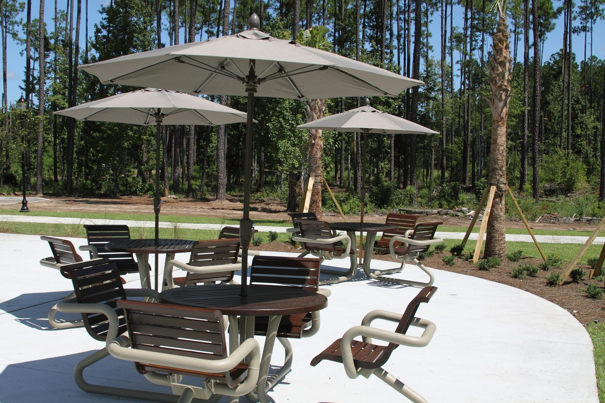 Dining sets with umbrellas on an outdoor patio