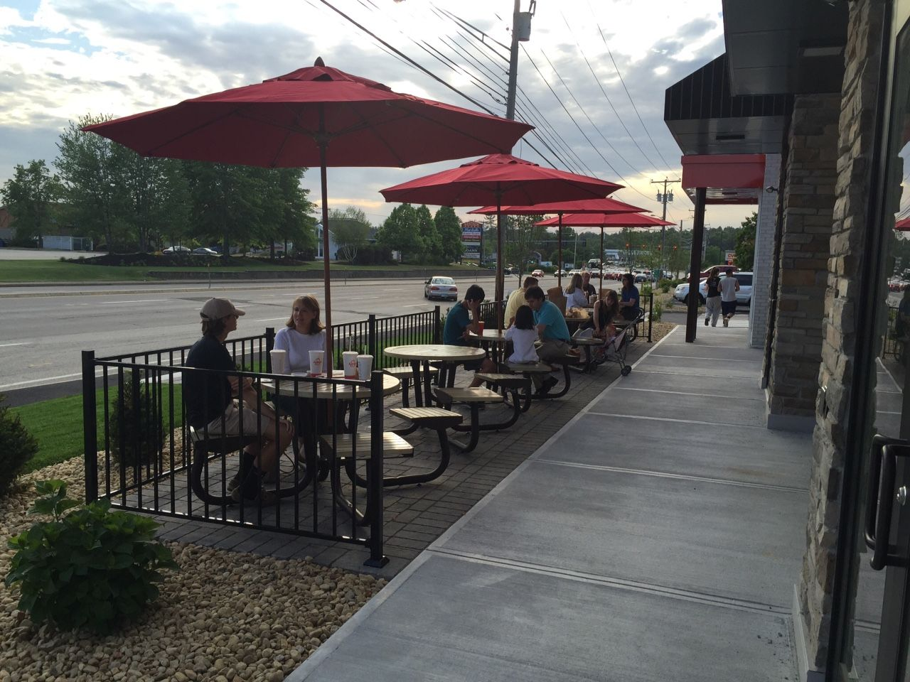 People eating at an outdoor restaurant