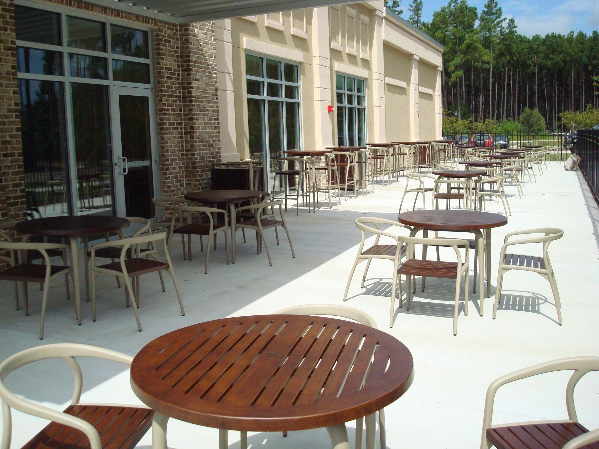 Rows of outdoor dining sets on a patio