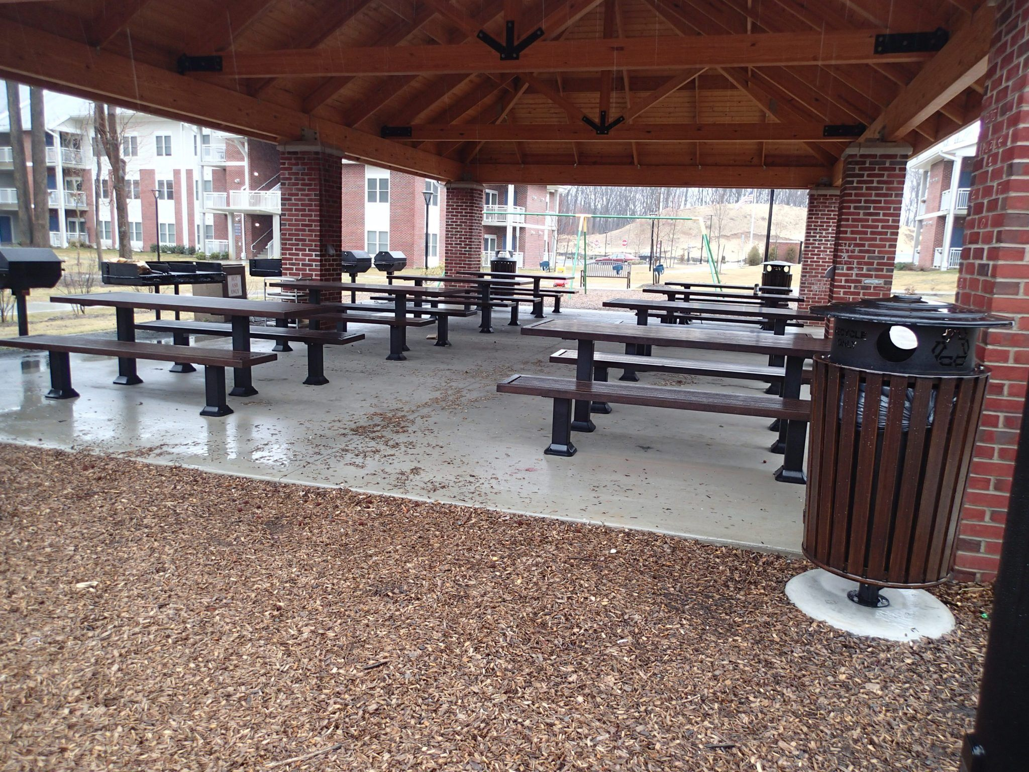 Rows of black picnic tables