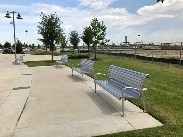 Silver benches outside of a park